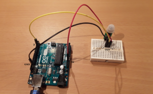 Pin layout used in this tutorial to wire the HC-SR505 PIR sensor to the Arduino Uno.