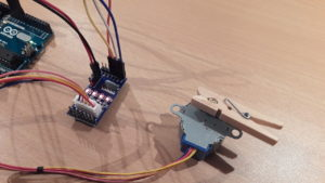 The stepper motor is driven by the ULN2003A driver board. The board's LEDs show the current control sequence state.