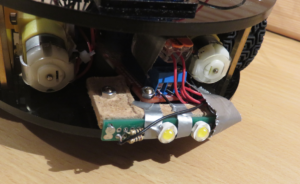 The headlights augmentation consists of a relay breakout board and a pair of power LEDs.