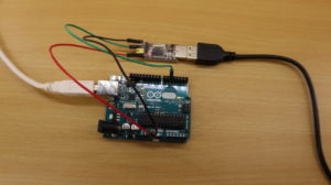 USB-to-TTL serial adapter connected to an Arduino Uno.