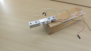 Load cell mounted on squared timber.