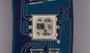 WS2813B-Mini RGB chip mounted on an LED ring.